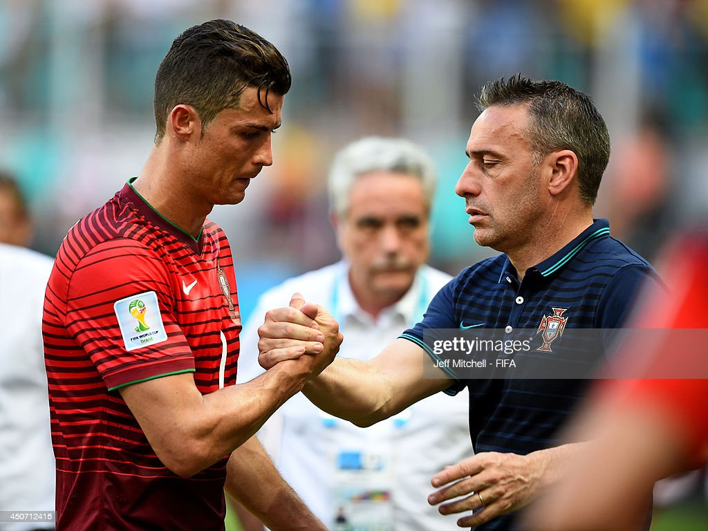 Cristiano Ronaldo of Portugal (L) is consoled by coach Paulo Bento of Portugal after the 2014 FIFA World Cup Brazil Group G match between Germany and Portugal at Arena Fonte Nova on June 16, 2014 in Salvador, Brazil.