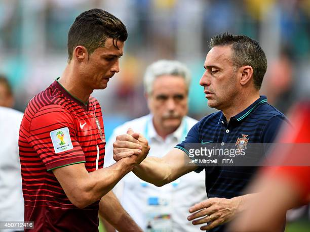 Cristiano Ronaldo of Portugal is consoled by coach Paulo Bento of Portugal after the 2014 FIFA World Cup Brazil Group G match between Germany and...