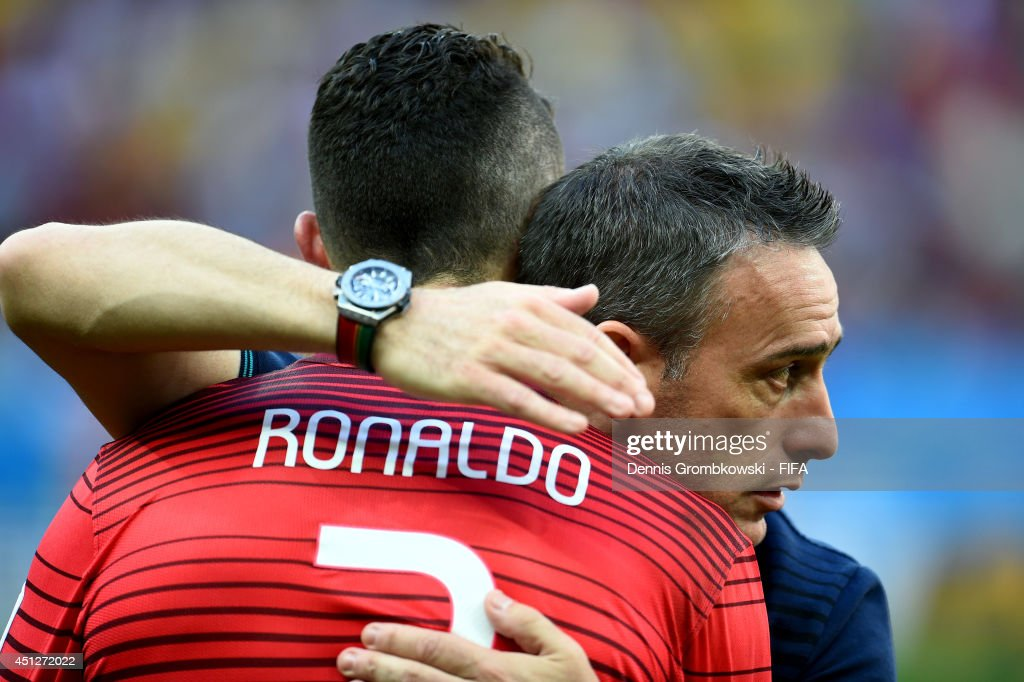 <a gi-track='captionPersonalityLinkClicked' href=/galleries/search?phrase=Cristiano+Ronaldo+-+Soccer+Player&family=editorial&specificpeople=162689 ng-click='$event.stopPropagation()'>Cristiano Ronaldo</a> of Portugal is consoled by coach <a gi-track='captionPersonalityLinkClicked' href=/galleries/search?phrase=Paulo+Bento&family=editorial&specificpeople=2076425 ng-click='$event.stopPropagation()'>Paulo Bento</a> of Portugal after the 2014 FIFA World Cup Brazil Group G match between Portugal and Ghana at Estadio Nacional on June 26, 2014 in Brasilia, Brazil.