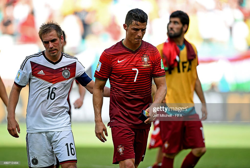 Cristiano Ronaldo of Portugal (C) is consoled by Philipp Lahm of Germany after the 2014 FIFA World Cup Brazil Group G match between Germany and Portugal at Arena Fonte Nova on June 16, 2014 in Salvador, Brazil.