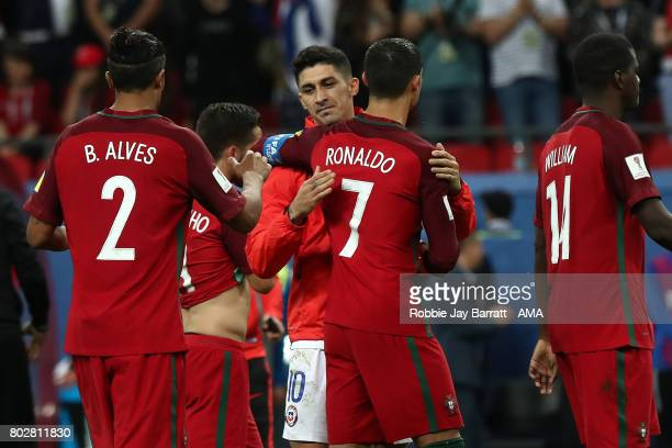 Cristiano Ronaldo of Portugal is embraced by Pablo Hernandez of Chile after a penalty shootout during the FIFA Confederations Cup Russia 2017...
