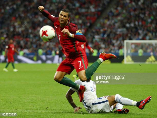 Cristiano Ronaldo of Portugal is fouled by Arturo Vidal of Chile during the FIFA Confederations Cup Russia 2017 SemiFinal between Portugal and Chile...