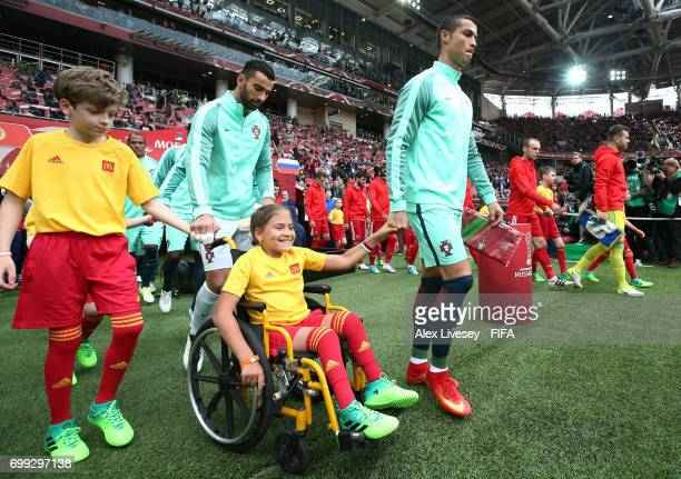 Cristiano Ronaldo of Portugal leads his team out prior to the FIFA Confederations Cup Russia 2017 Group A match between Russia and Portugal at...