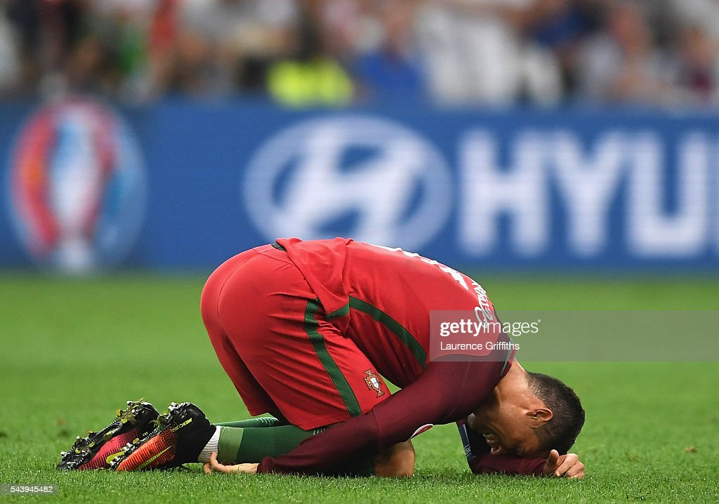 <a gi-track='captionPersonalityLinkClicked' href=/galleries/search?phrase=Cristiano+Ronaldo+-+Soccer+Player&family=editorial&specificpeople=162689 ng-click='$event.stopPropagation()'>Cristiano Ronaldo</a> of Portugal lies injured during the UEFA EURO 2016 quarter final match between Poland and Portugal at Stade Velodrome on June 30, 2016 in Marseille, France.