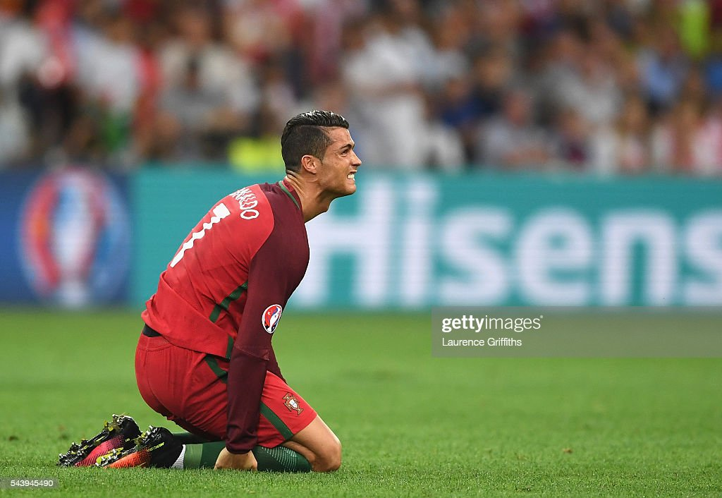 Cristiano Ronaldo of Portugal lies injured during the UEFA EURO 2016 quarter final match between Poland and Portugal at Stade Velodrome on June 30, 2016 in Marseille, France.