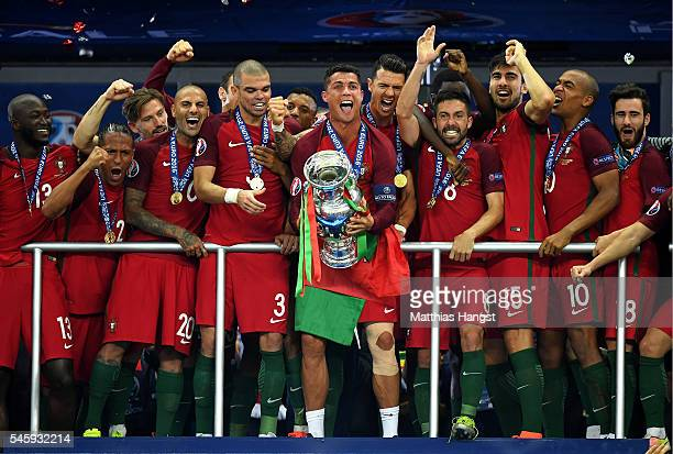 Cristiano Ronaldo of Portugal lifts the European Championship trophy after his side win 10 against France during the UEFA EURO 2016 Final match...