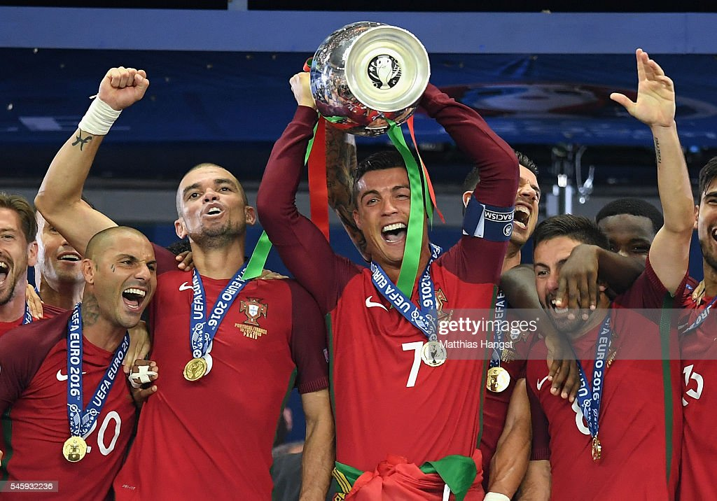 Cristiano Ronaldo of Portugal (c) lifts the European Championship trophy after his side win 1-0 against France during the UEFA EURO 2016 Final match between Portugal and France at Stade de France on July 10, 2016 in Paris, France.