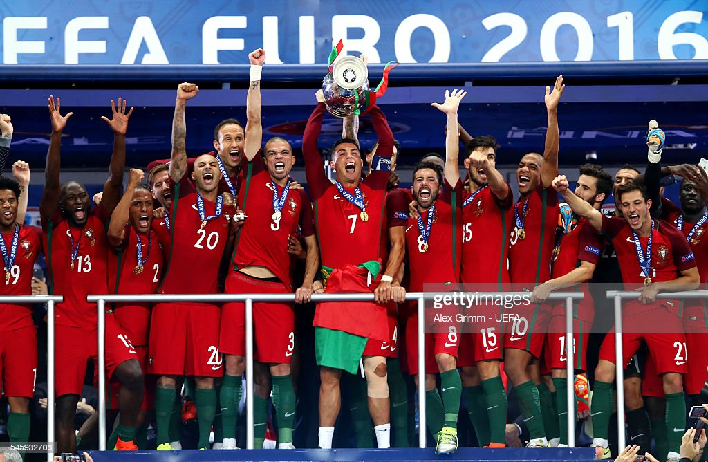 Cristiano Ronaldo of Portugal (c) lifts the Henri Delaunay trophy after his side win 1-0 against France during the UEFA EURO 2016 Final match between Portugal and France at Stade de France on July 10, 2016 in Paris, France.