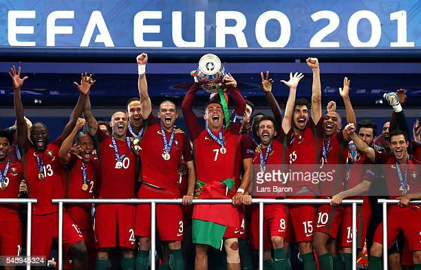Cristiano Ronaldo of Portugal lifts the Henri Delaunay trophy after his side win 10 against France during the UEFA EURO 2016 Final match between...