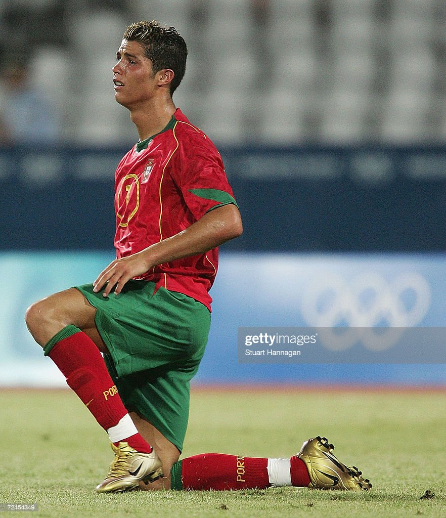 <a gi-track='captionPersonalityLinkClicked' href=/galleries/search?phrase=Cristiano+Ronaldo+-+Voetballer&family=editorial&specificpeople=162689 ng-click='$event.stopPropagation()'>Cristiano Ronaldo</a> #7 of Portugal looks dejected after Iraq's 4-2 victory over Portugal in the men's football preliminary match between Iraq and Portugal during the Athens 2004 Summer Olympic Games at Pampeloponnisiako Stadium on August 12, 2004 in Patras, Greece.
