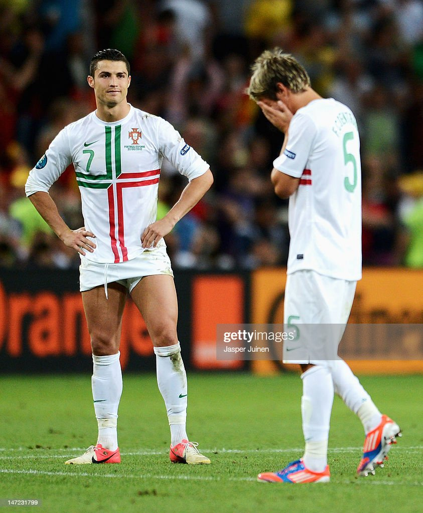 <a gi-track='captionPersonalityLinkClicked' href=/galleries/search?phrase=Cristiano+Ronaldo+-+Soccer+Player&family=editorial&specificpeople=162689 ng-click='$event.stopPropagation()'>Cristiano Ronaldo</a> of Portugal looks dejected after losing a penalty shoot out during the UEFA EURO 2012 semi final match between Portugal and Spain at Donbass Arena on June 27, 2012 in Donetsk, Ukraine.