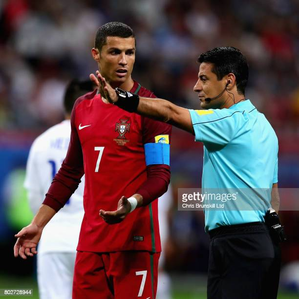Cristiano Ronaldo of Portugal looks on as referee Alireza Faghani signals during the FIFA Confederations Cup Russia 2017 SemiFinal between Portugal...