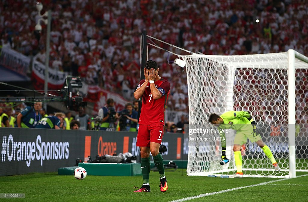 <a gi-track='captionPersonalityLinkClicked' href=/galleries/search?phrase=Cristiano+Ronaldo+-+Soccer+Player&family=editorial&specificpeople=162689 ng-click='$event.stopPropagation()'>Cristiano Ronaldo</a> of Portugal looks on dejected during the UEFA Euro 2016 quarter final match between Poland and Portugal at Stade Velodrome on June 30, 2016 in Marseille, France.