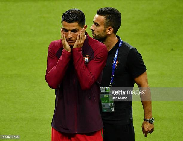 Cristiano Ronaldo of Portugal looks on dejected prior to the start of extratime during the UEFA EURO 2016 Final match between Portugal and France at...
