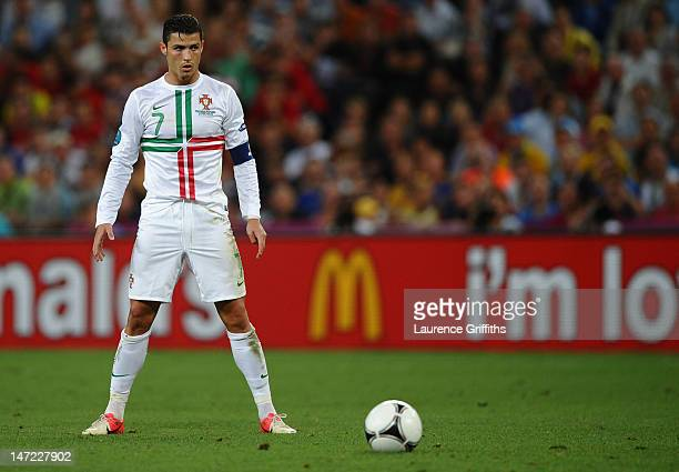 Cristiano Ronaldo of Portugal prepares to take a free kick during the UEFA EURO 2012 semi final match between Portugal and Spain at Donbass Arena on...