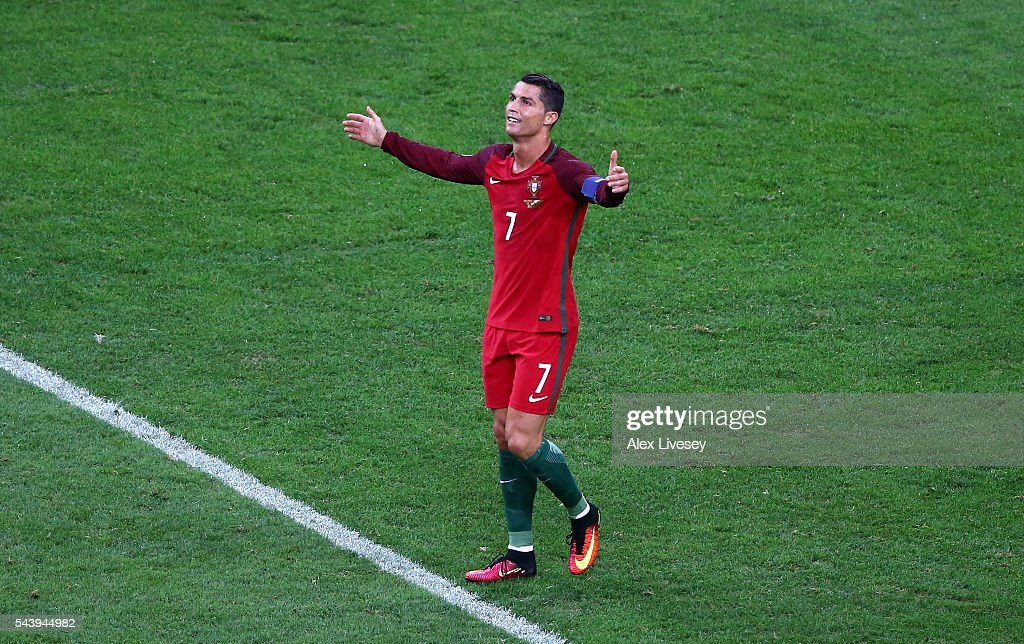 <a gi-track='captionPersonalityLinkClicked' href=/galleries/search?phrase=Cristiano+Ronaldo+-+Soccer+Player&family=editorial&specificpeople=162689 ng-click='$event.stopPropagation()'>Cristiano Ronaldo</a> of Portugal reacts after callenged by Michal Pazdan of Poland in the penalty area during the UEFA EURO 2016 quarter final match between Poland and Portugal at Stade Velodrome on June 30, 2016 in Marseille, France.