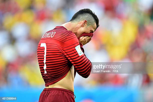 Cristiano Ronaldo of Portugal reacts after failing to qualify for the knock out stage despite the 21 win in the 2014 FIFA World Cup Brazil Group G...