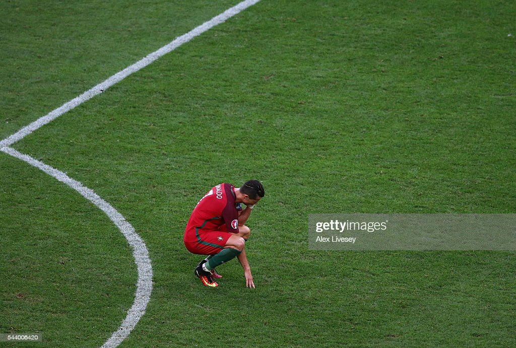 <a gi-track='captionPersonalityLinkClicked' href=/galleries/search?phrase=Cristiano+Ronaldo+-+Soccer+Player&family=editorial&specificpeople=162689 ng-click='$event.stopPropagation()'>Cristiano Ronaldo</a> of Portugal reacts after the extra time during the UEFA EURO 2016 quarter final match between Poland and Portugal at Stade Velodrome on June 30, 2016 in Marseille, France.