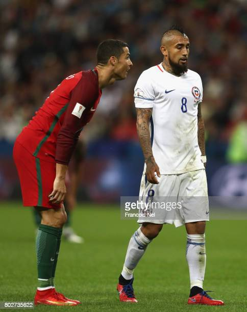 Cristiano Ronaldo of Portugal reacts as Arturo Vidal of Chile looks on during the FIFA Confederations Cup Russia 2017 SemiFinal between Portugal and...