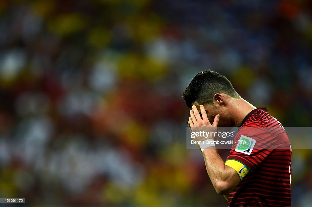 <a gi-track='captionPersonalityLinkClicked' href=/galleries/search?phrase=Cristiano+Ronaldo+-+Voetballer&family=editorial&specificpeople=162689 ng-click='$event.stopPropagation()'>Cristiano Ronaldo</a> of Portugal reacts during the 2014 FIFA World Cup Brazil Group G match between USA and Portugal at Arena Amazonia on June 22, 2014 in Manaus, Brazil.