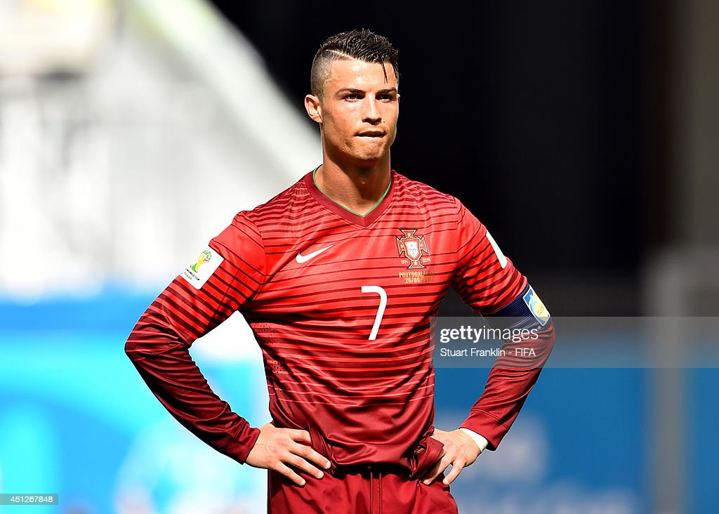 <a gi-track='captionPersonalityLinkClicked' href=/galleries/search?phrase=Cristiano+Ronaldo+-+Voetballer&family=editorial&specificpeople=162689 ng-click='$event.stopPropagation()'>Cristiano Ronaldo</a> of Portugal reacts during the 2014 FIFA World Cup Brazil Group G match between Portugal and Ghana at Estadio Nacional on June 26, 2014 in Brasilia, Brazil.