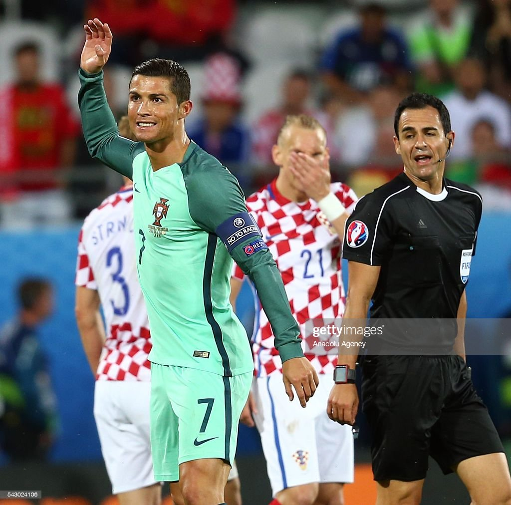 Cristiano Ronaldo (L) of Portugal reacts during the Euro 2016 round of 16 football match between Croatia and Portugal at Stade Bollaert-Delelis in Lens, France on June 25, 2016.
