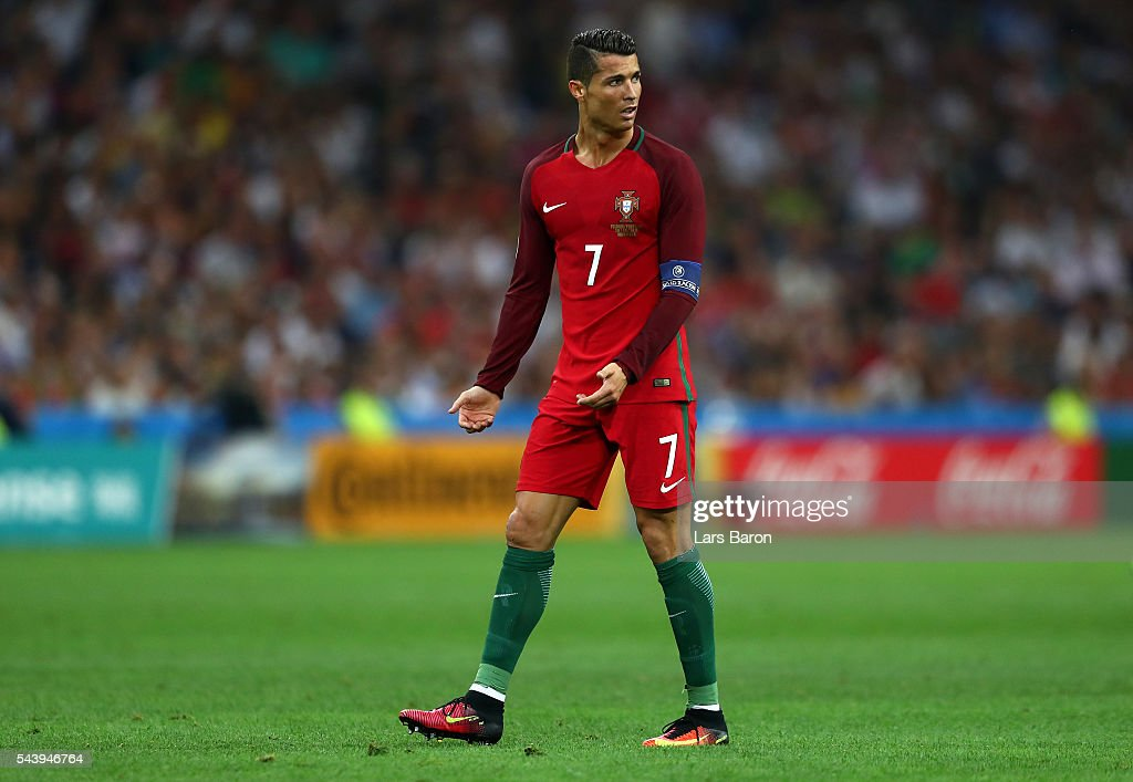 <a gi-track='captionPersonalityLinkClicked' href=/galleries/search?phrase=Cristiano+Ronaldo+-+Soccer+Player&family=editorial&specificpeople=162689 ng-click='$event.stopPropagation()'>Cristiano Ronaldo</a> of Portugal reacts during the UEFA EURO 2016 quarter final match between Poland and Portugal at Stade Velodrome on June 30, 2016 in Marseille, France.