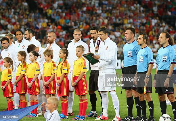 Cristiano Ronaldo of Portugal reads a Respect message ahead of the UEFA EURO 2012 semi final match between Portugal and Spain at Donbass Arena on...
