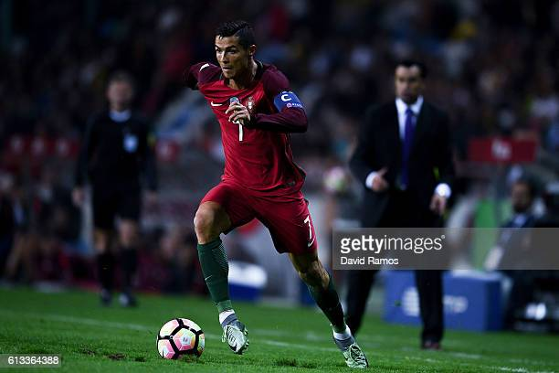 Cristiano Ronaldo of Portugal runs with the ball during the FIFA 2018 World Cup Qualifier between Portugal and Andorra at Estadio Municipal de Aveiro...