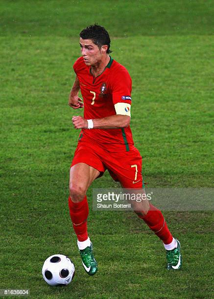 Cristiano Ronaldo of Portugal rusns with the ball during the UEFA EURO 2008 Quarter Final match between Portugal and Germany at St JakobPark on June...