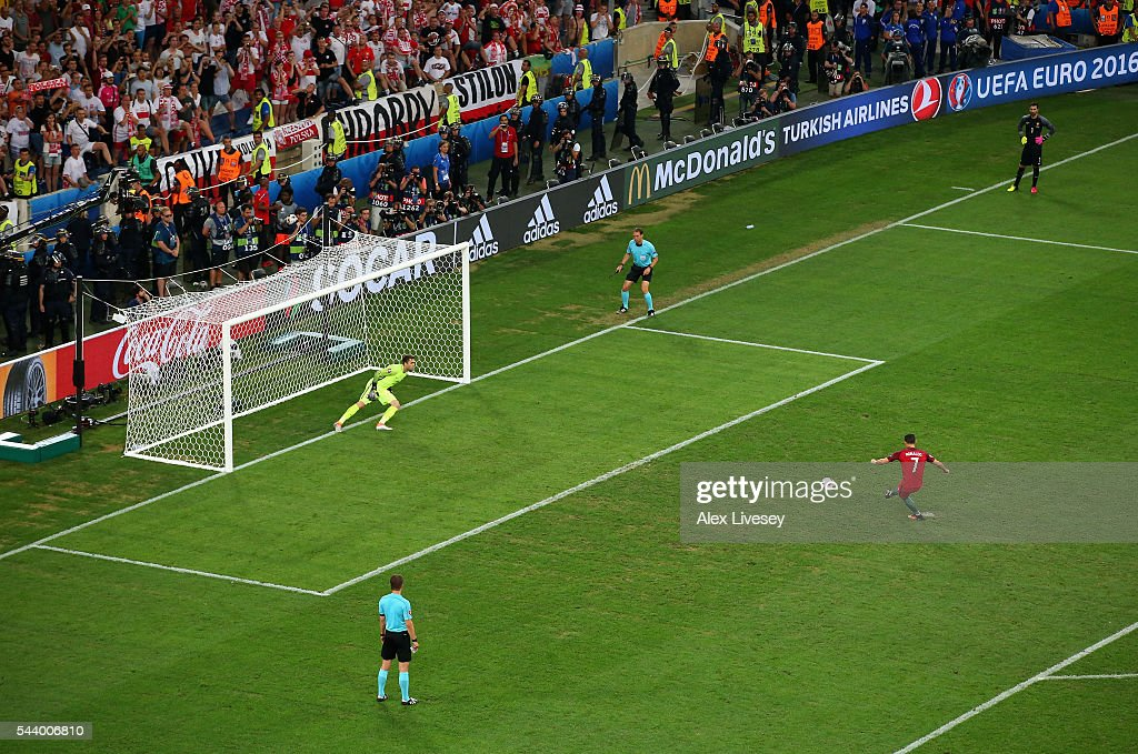 <a gi-track='captionPersonalityLinkClicked' href=/galleries/search?phrase=Cristiano+Ronaldo+-+Soccer+Player&family=editorial&specificpeople=162689 ng-click='$event.stopPropagation()'>Cristiano Ronaldo</a> of Portugal scores at the penalty shootout during the UEFA EURO 2016 quarter final match between Poland and Portugal at Stade Velodrome on June 30, 2016 in Marseille, France.