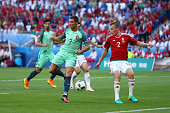 Cristiano Ronaldo of Portugal scores his team's second goal during the UEFA EURO 2016 Group F match between Hungary and Portugal at Stade des...