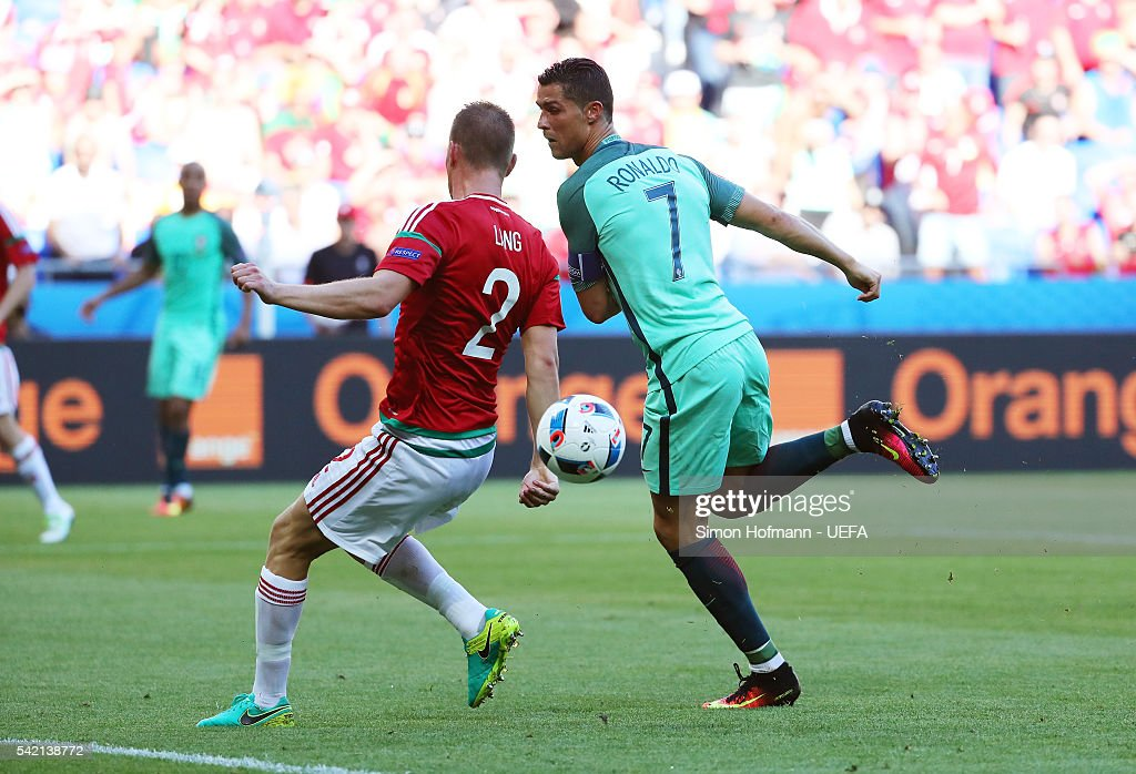 Cristiano Ronaldo of Portugal scores his team's second goal during the UEFA EURO 2016 Group F match between Hungary and Portugal at Stade des Lumieres on June 22, 2016 in Lyon, France.
