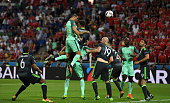Cristiano Ronaldo of Portugal scores the opening goal during the UEFA EURO 2016 semi final match between Portugal and Wales at Stade des Lumieres on...