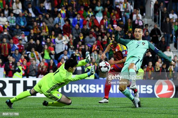 Cristiano Ronaldo of Portugal scores the opening goal past the goalkeeper Josep Gomes of Andorraduring the FIFA 2018 World Cup Qualifier between...