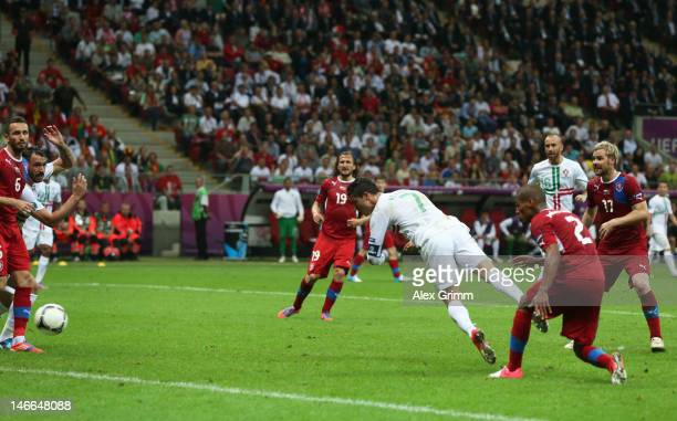 Cristiano Ronaldo of Portugal scores the opening goal with a header during the UEFA EURO 2012 quarter final match between Czech Republic and Portugal...