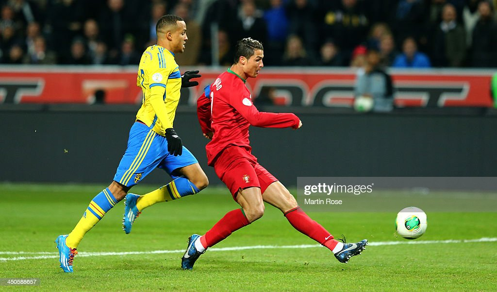 <a gi-track='captionPersonalityLinkClicked' href=/galleries/search?phrase=Cristiano+Ronaldo+-+Soccer+Player&family=editorial&specificpeople=162689 ng-click='$event.stopPropagation()'>Cristiano Ronaldo</a> of Portugal scores their opening goal during the FIFA 2014 World Cup Qualifier Play-off Second Leg match between Sweden and Portugal at Friends Arena on November 19, 2013 in Stockholm, Sweden.