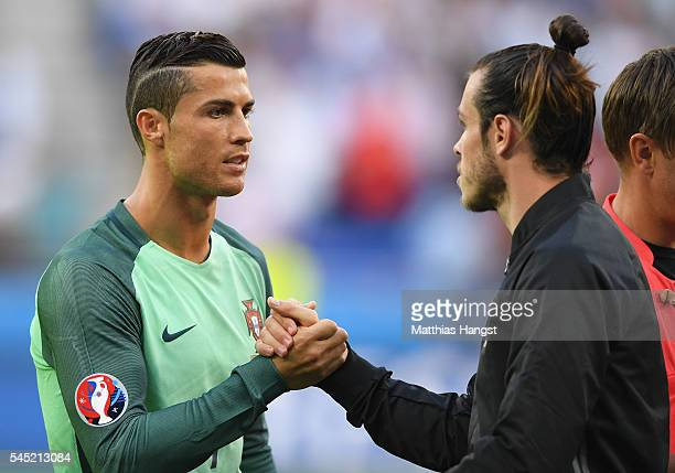 Cristiano Ronaldo of Portugal shakes hands with Gareth Bale of Wales before the UEFA EURO 2016 semi final match between Portugal and Wales at Stade...