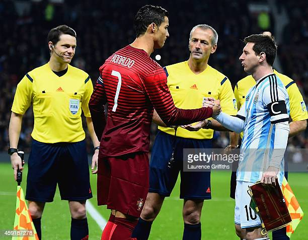 Cristiano Ronaldo of Portugal shakes hands with Lionel Messi of Argentina prior to the International Friendly between Argentina and Portugal at Old...