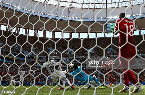 Cristiano Ronaldo of Portugal shoots and scores his team's second goal during the 2014 FIFA World Cup Brazil Group G match between Portugal and Ghana...