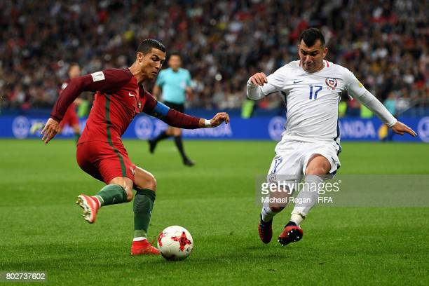 Cristiano Ronaldo of Portugal shoots as Gary Medel of Chile attempts to block during the FIFA Confederations Cup Russia 2017 SemiFinal between...