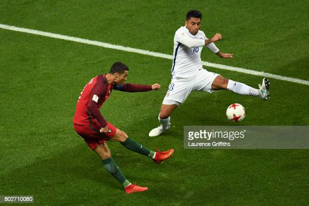 Cristiano Ronaldo of Portugal shoots as Gonzalo Jara of Chile attempts to block during the FIFA Confederations Cup Russia 2017 SemiFinal between...