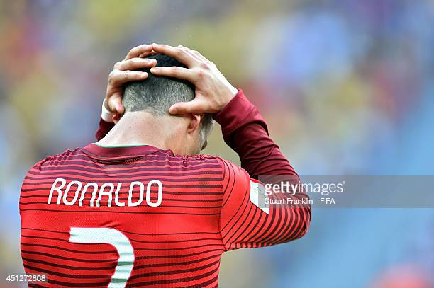Cristiano Ronaldo of Portugal shows his dejection after the 2014 FIFA World Cup Brazil Group G match between Portugal and Ghana at Estadio Nacional...