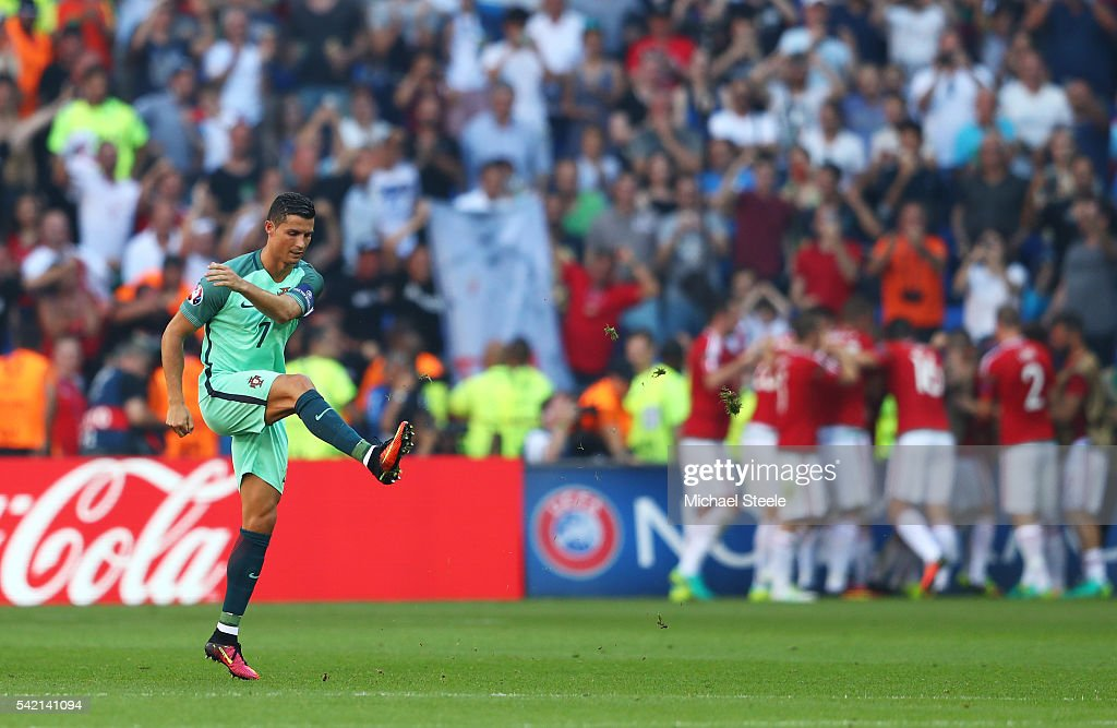 Cristiano Ronaldo of Portugal shows his frustration after Hungary's second goal during the UEFA EURO 2016 Group F match between Hungary and Portugal at Stade des Lumieres on June 22, 2016 in Lyon, France.