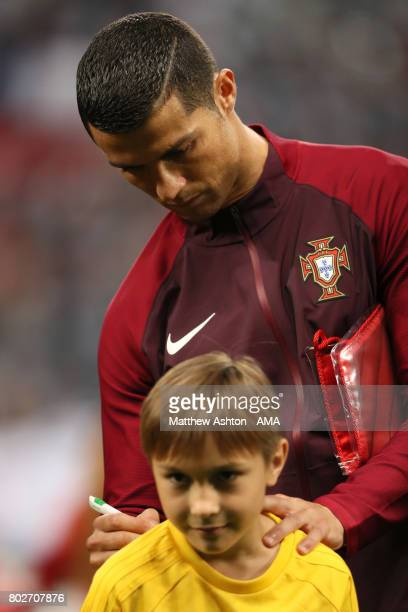Cristiano Ronaldo of Portugal signs a mascots shirt prior to the FIFA Confederations Cup Russia 2017 SemiFinal match between Portugal and Chile at...