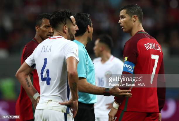 Cristiano Ronaldo of Portugal speaks to referee Alireza Faghani during the FIFA Confederations Cup Russia 2017 SemiFinal match between Portugal and...