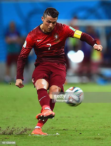 Cristiano Ronaldo of Portugal takes a free kick during the 2014 FIFA World Cup Brazil Group G match between the United States and Portugal at Arena...