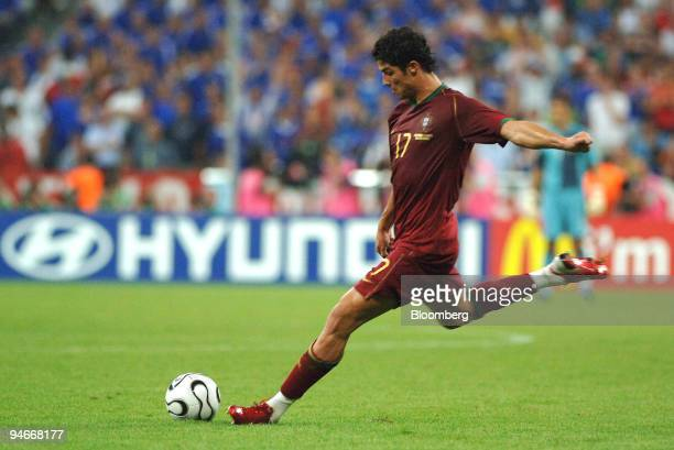 Cristiano Ronaldo of Portugal takes a free kick during the team's 10 defeat by France in a semifinal match at the 2006 FIFA World Cup in Munich...