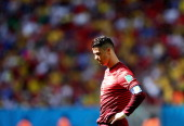 Cristiano Ronaldo of Portugal takes a moment after the 2014 FIFA World Cup Brazil Group G match between Portugal v Ghana at Estadio Nacional on June...