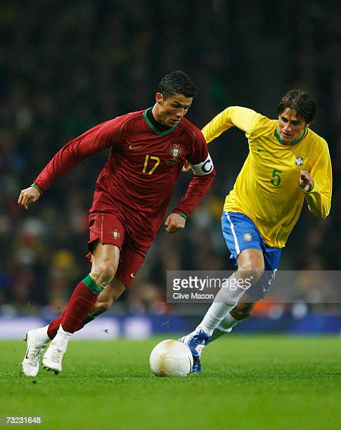 Cristiano Ronaldo of Portugal takes on Edmilson of Brazil during the International friendly match between Brazil and Portugal at the Emirates Stadium...